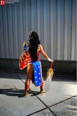 Back side of of Yaya Han as Wonder Woman with sword and shield