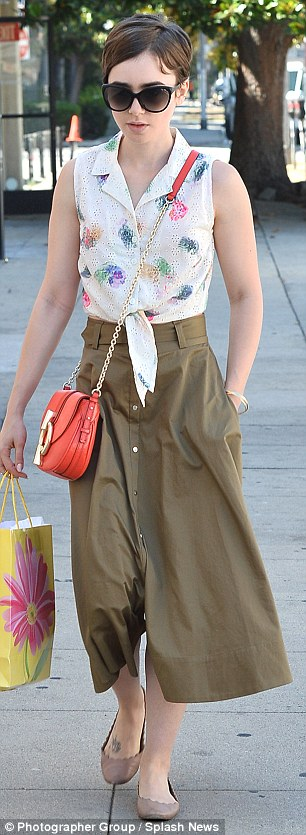Lily Collins in IVI Daggerwing Sunglasses