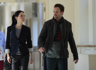 Jonny Lee Miller and Lucy Liu as Sherlock Holmes and Joan Watson in Elementary Episode # 5 Lesser Evils