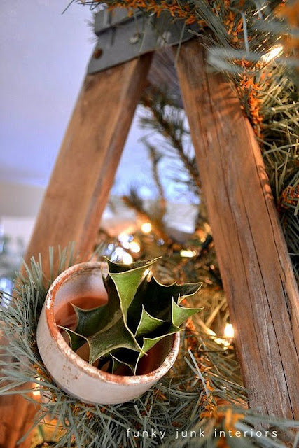 Potted holly ornament / The making of a stepladder Christmas tree, via : http://www.funkyjunkinteriors.net/