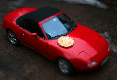 Giant Coin Makes Stuff Look Tiny In Tilt-Shift Photos Seen On www.coolpicturegallery.us