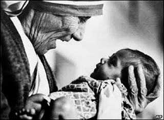 Mother Theresa holding a baby