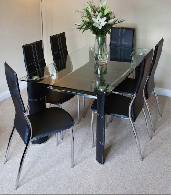 Cool Dining Set Modern Glass Chrome Table and Black Faux Leather Chairs for sale This is a fantastic Dining Set with such an appealing design