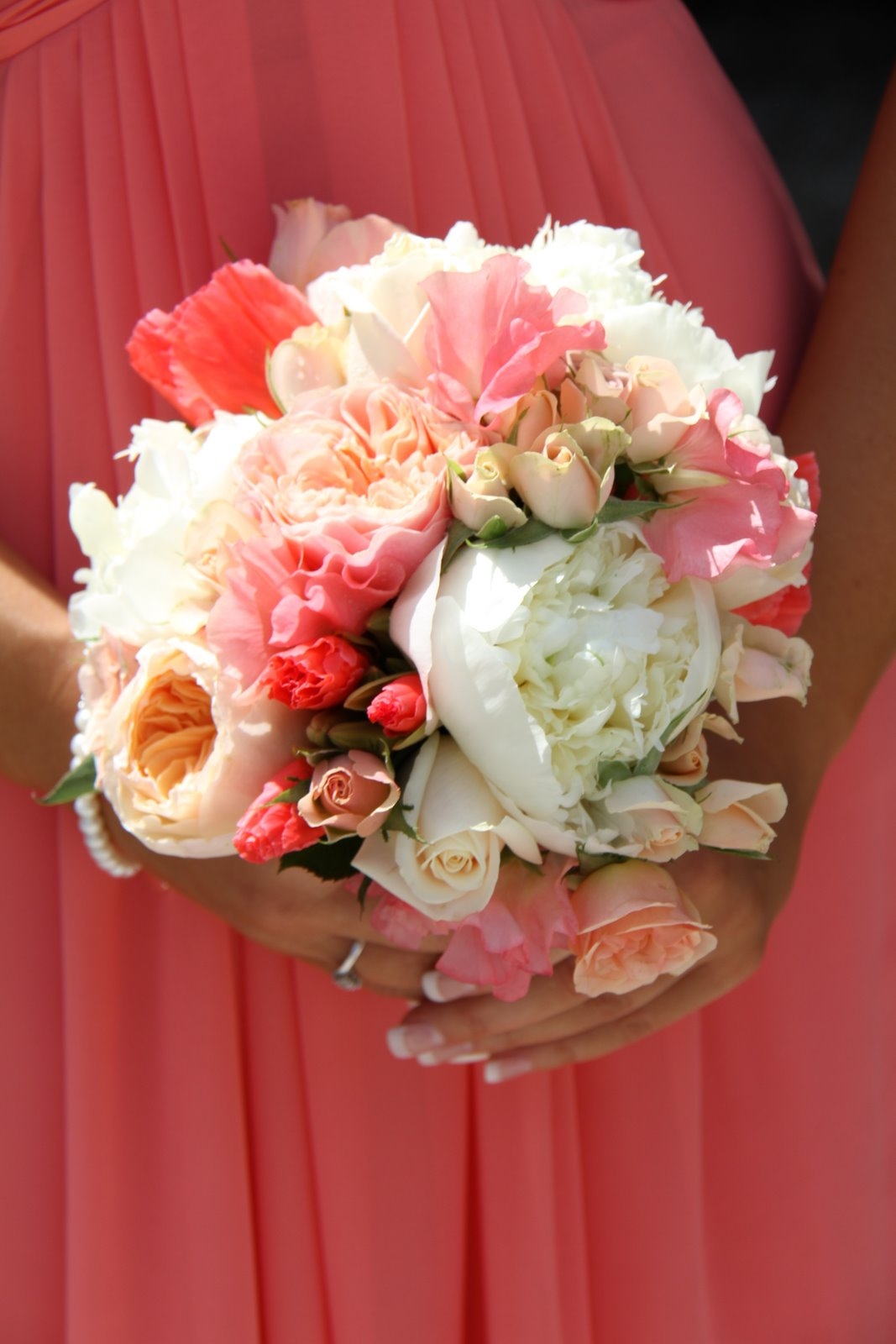 peas and peonies toned exquisitely with their coral shaded bridesmaid