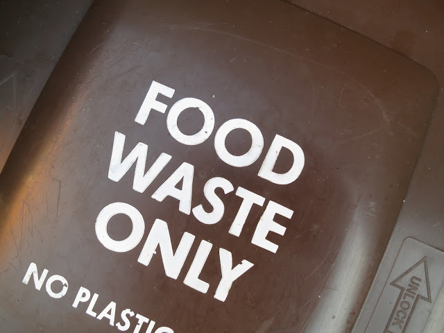 Top of a brown plastic bin for food waste.