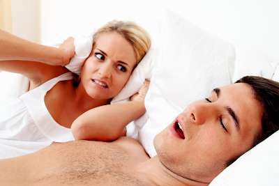 A guy snoring while his girlfriend is trying to sleep