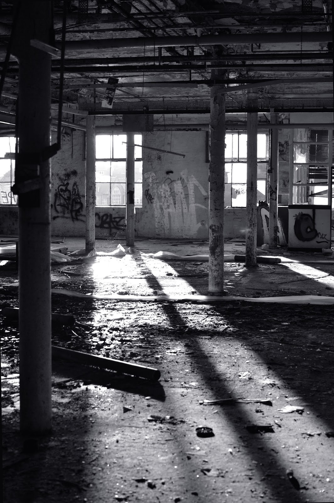 urbex, photography, black and white, tone, atmosphere, fothergill and harvey, rock nook mill, shadows, narrative, eerie, factory, abandoned, derelict, light, natural light, society, greater Manchester, Littleborough, industrial revolution, ruins, apocalypse, separation, place, explore, adventure,
