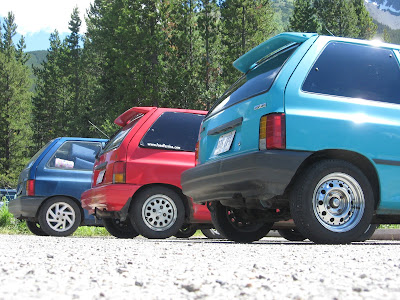 Ford Festiva, econobox, red Ford Festiva, blue Ford Festiva