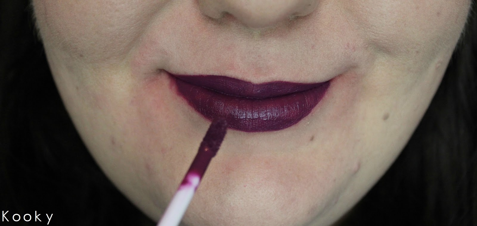 a liquid lipstick in berry shade