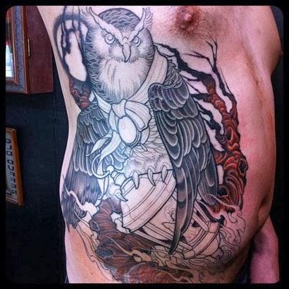 Tattoos de corujas nas costelas para homens