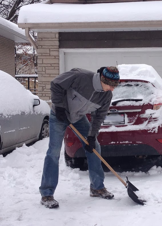 Tall Man Using Average Snow Shovel