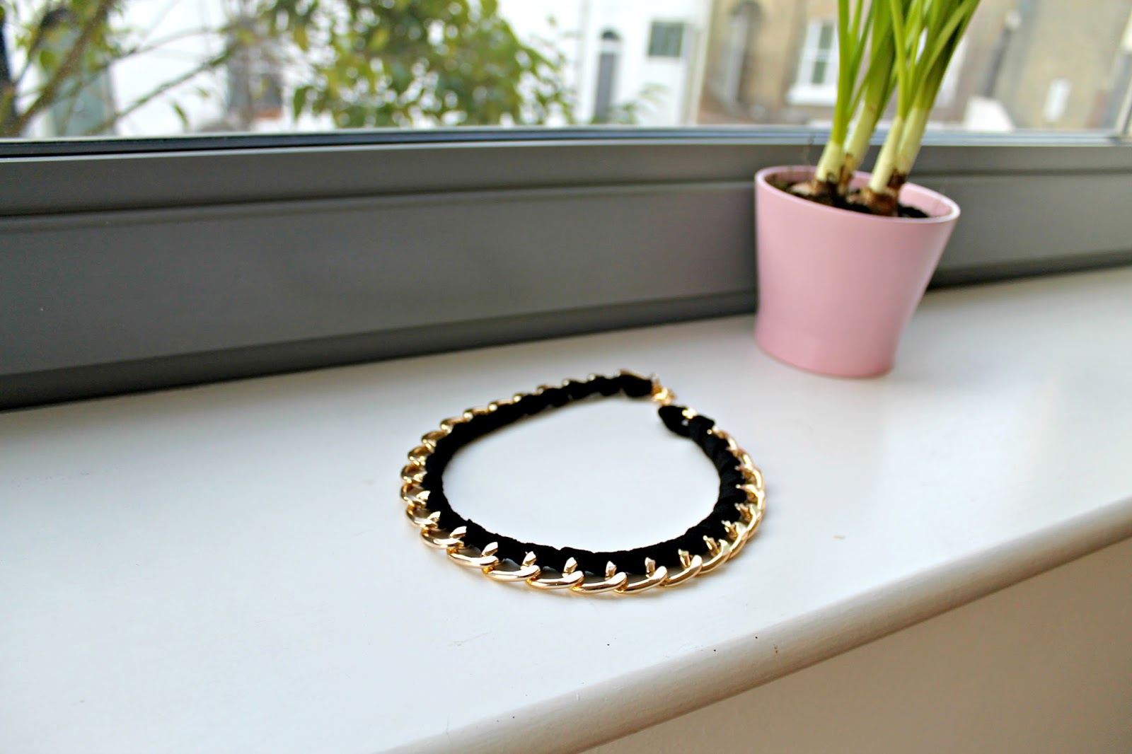 a black and gold rope chain necklace