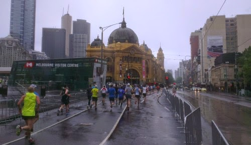 Running in the rain towards Flinders Street Station