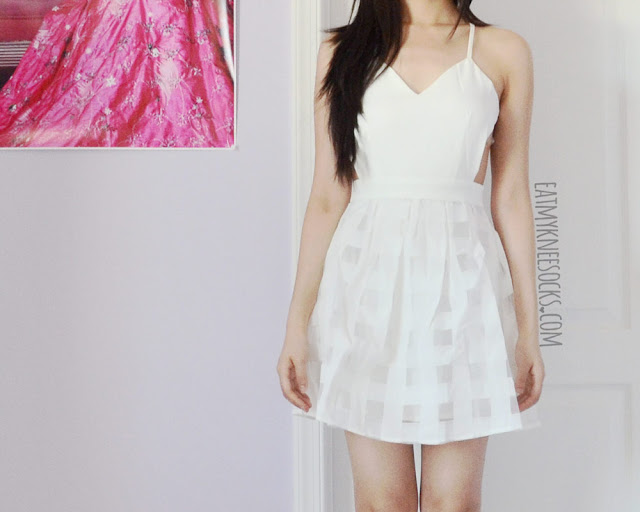 Modeled photos of the white backless spaghetti-strap grid flare organza dress from SheIn.
