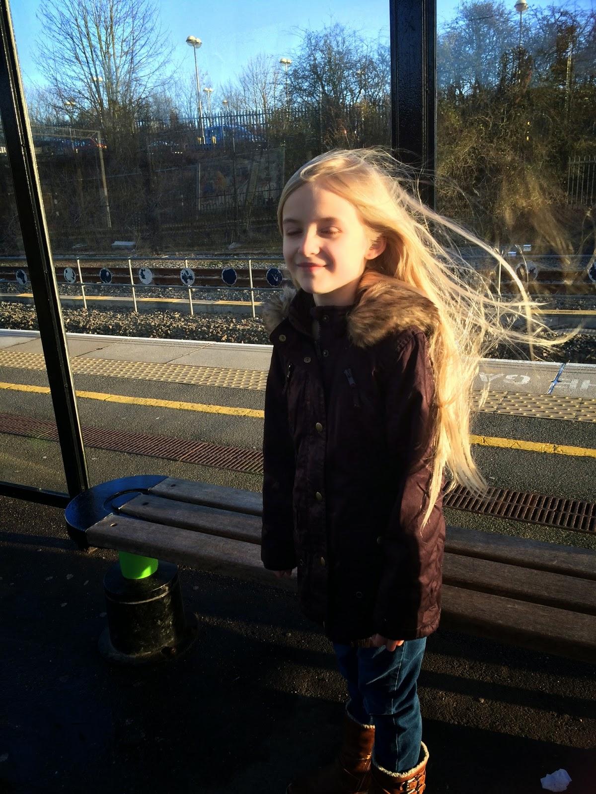 8-yr-old wearing purple parka from Morrisons Nutmeg clothing range