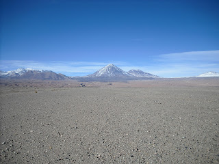 A typical shot of Northern Chile - blue skies with snow-topped mountains interrupting expanses of desert.