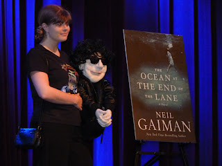 woman with Gaiman muppet