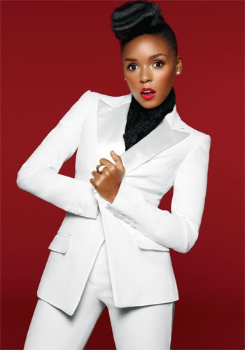 Janelle Monae appeared at Paris Fashion Week today wearing the Stella McCartney Pom-Pom Embellished Cotton Sweatshirt ($), a star print skirt from Neil Barrett similar to this ($).