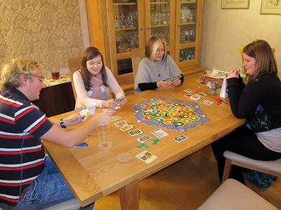 Settlers of Catan - The players with lots of cards!