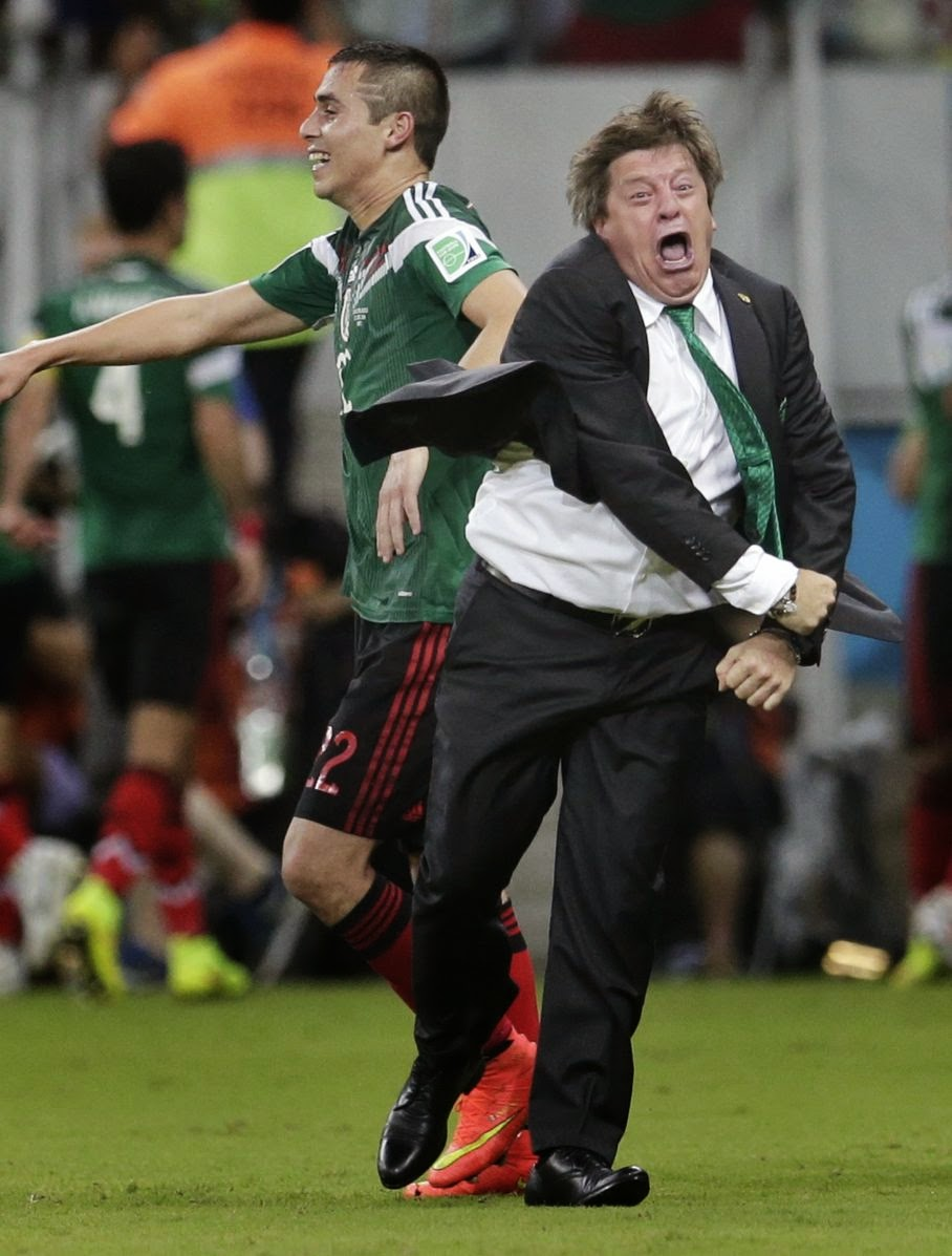 Mexico's head coach Miguel Herrera celebrates after Mexico's Andres Guardado scored his side's second goal during the group A World Cup soccer match between Croatia and Mexico at the Arena Pernambuco in Recife, Brazil, Monday, June 23, 2014.