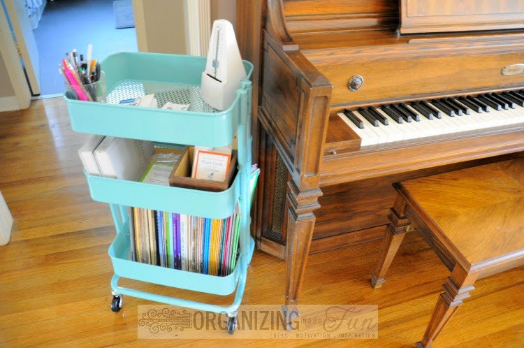 Cute, Organized Ikea Raskög Cart to organize piano things :: OrganizingMadeFun.com