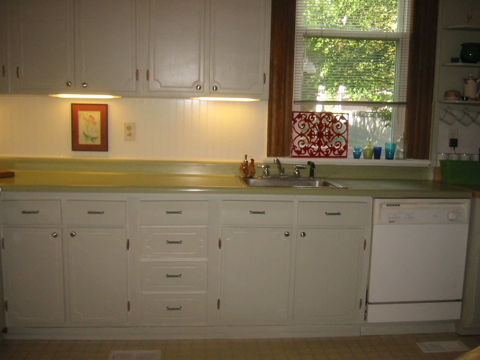 this kitchen probably hadn u0027t been touched since the 40 u0027s 50 u0027s  plywood cabinets with a horrible dark wood stain  sheshe the home magician  to paint or not to paint  those ugly      rh   sheshehome blogspot com