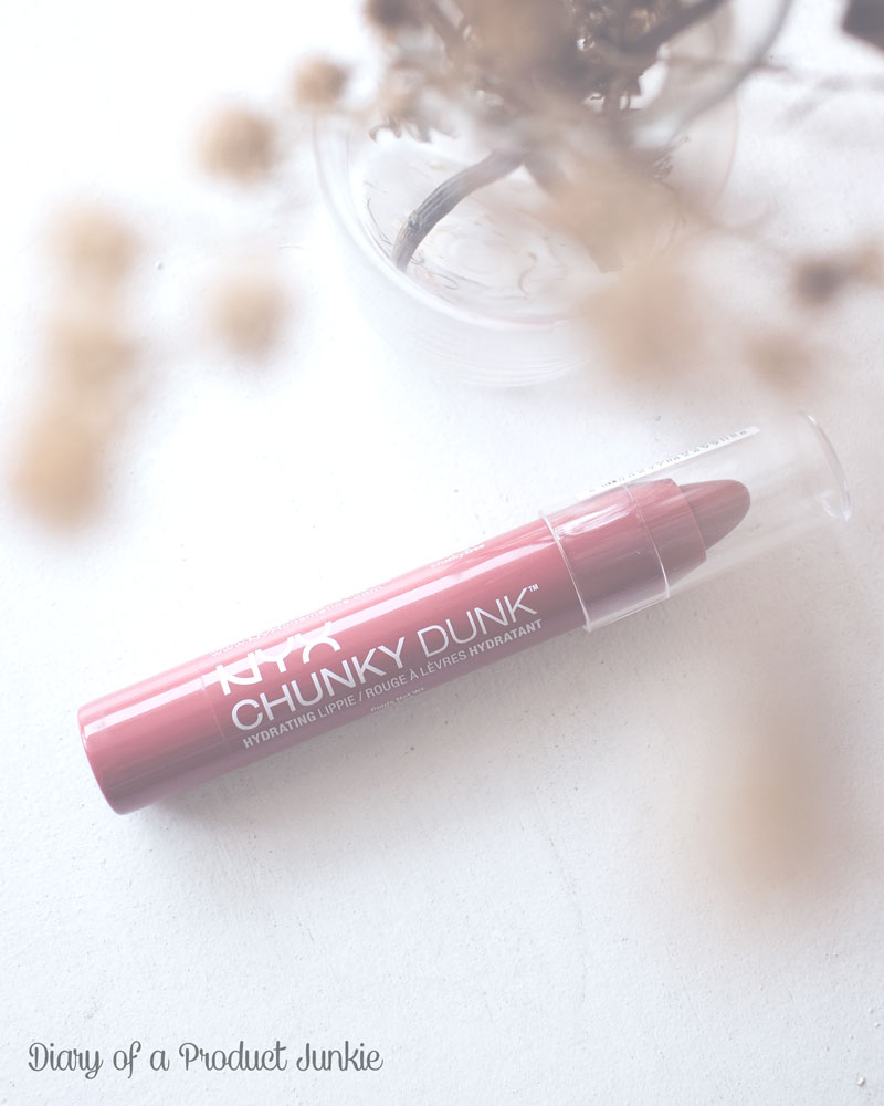 NYX Chunky Dunk Lippie on a white wooden plank