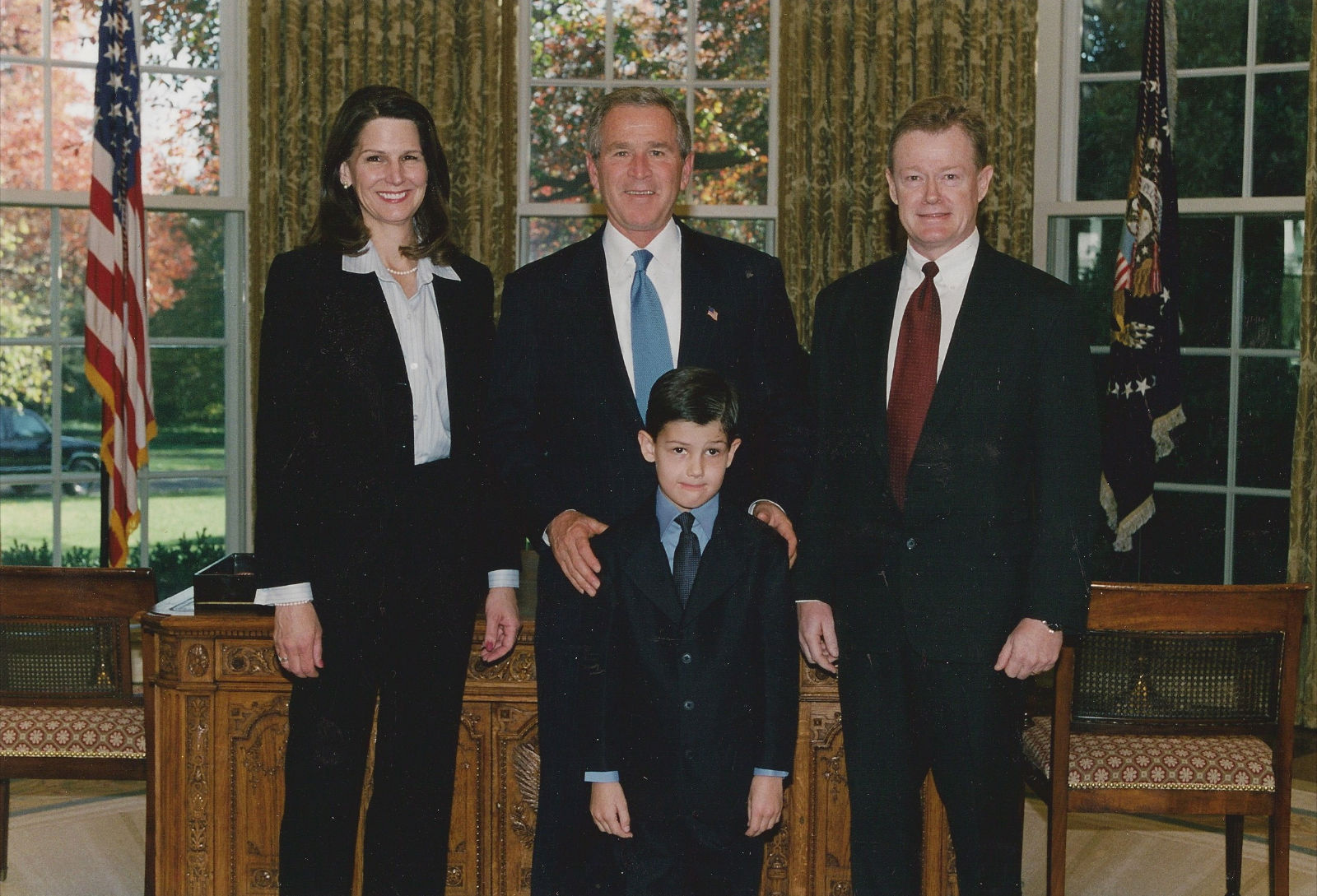 Dan Emmett, wife, and son with President Bush