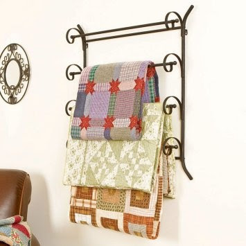 Quilts on an Iron Wall Rack