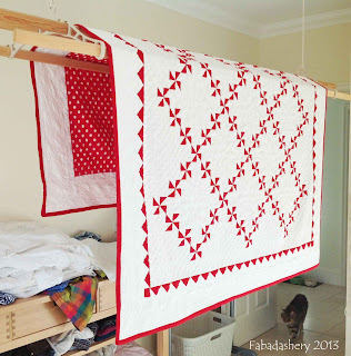 Red and White Pinwheel Quilt drying on the Sheila Maid