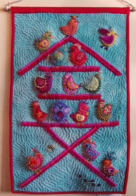 She Has Flown the Coop, a wall quilt by Bunny Starbuck, embroidery on wool applique