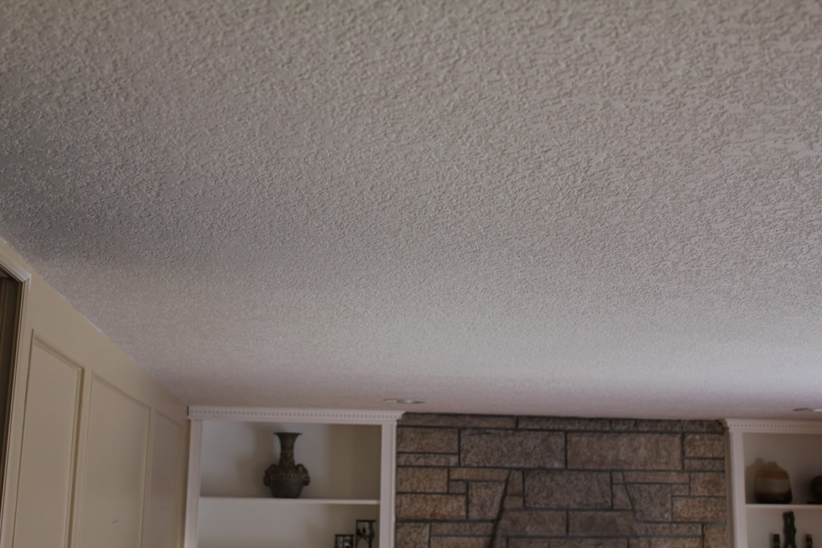 Popcorn texture removal, Knockdown application, step 6: Priming with latex paint and applying ...