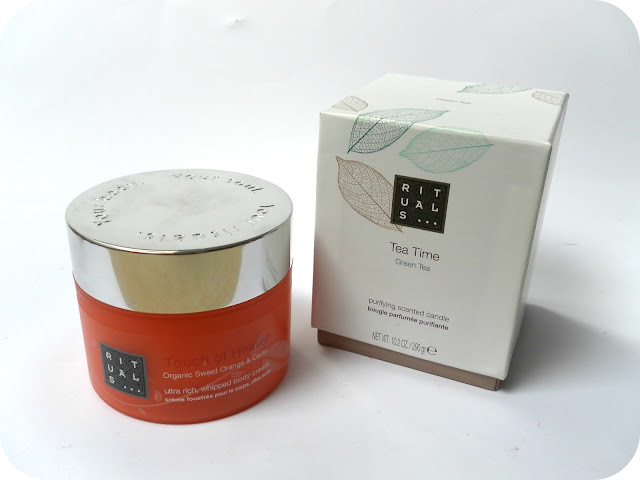 A picture of Rituals Organic Sweet Orange & Cedar Ultra Rich Whipped Body Cream and Rituals Tea Time Green Tea Candle