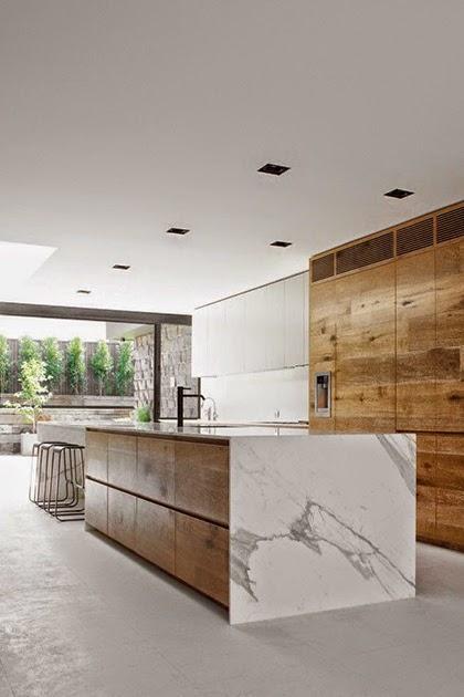 White walls, kitchen island, wood paneling, marble