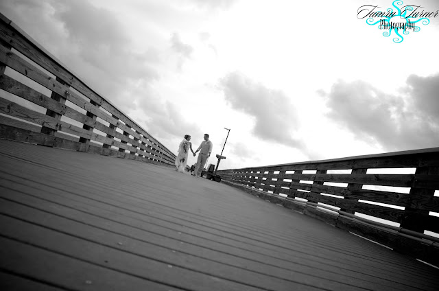 walking hand in hand on the fishing pier at St. Andrew's in Panama City Beach