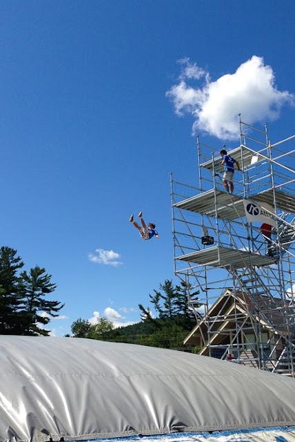 boy jumping from platform onto air bag