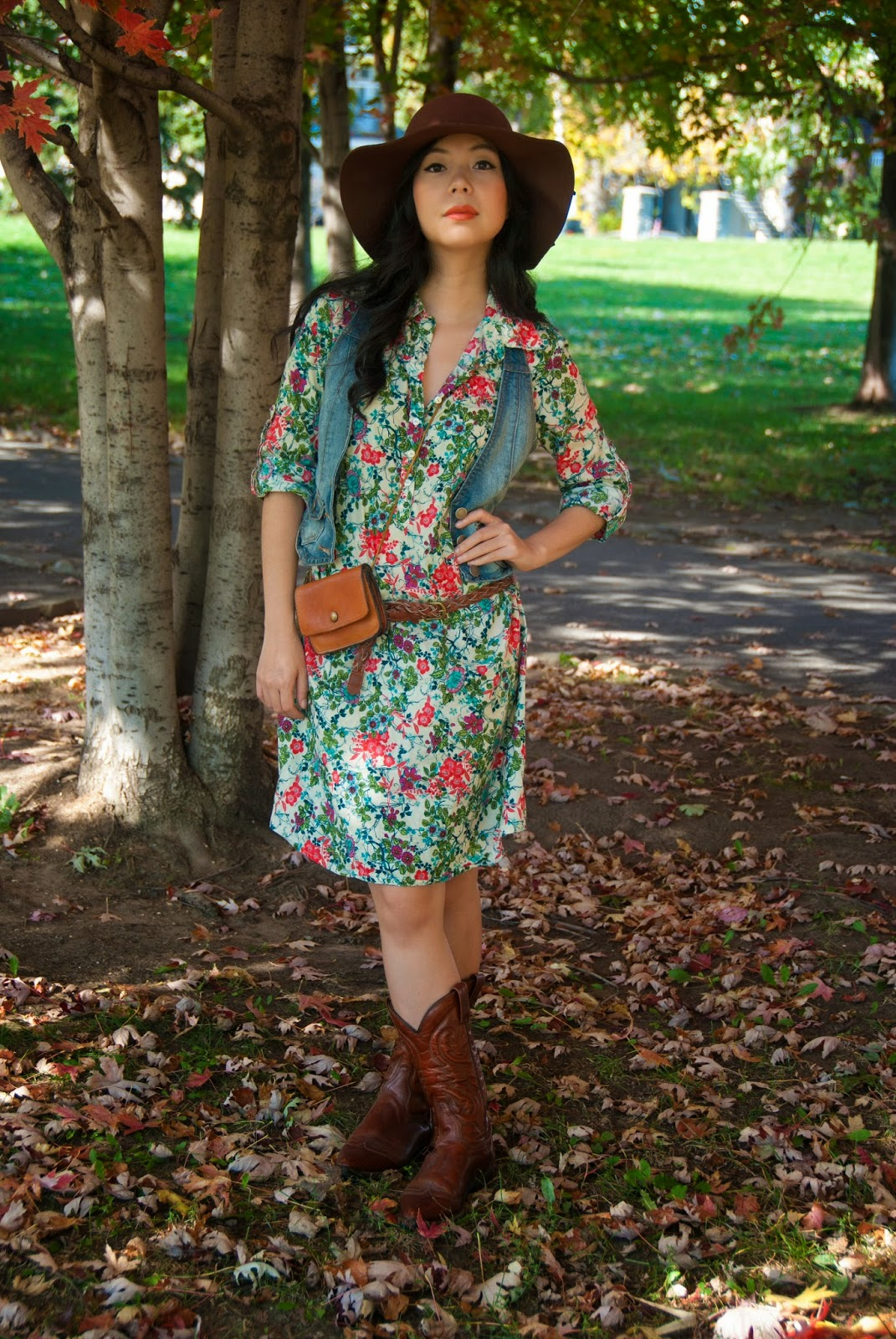 cowboy boots floral shirtdress braided belt leather purse floppy brown hat denim jean vest fall leaves