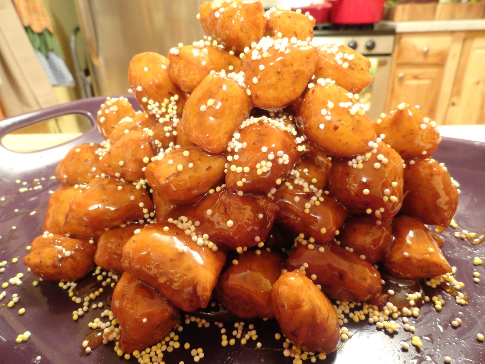Struffoli are little fried dough balls that are topped with honey and ...