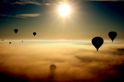 Balloons above the clouds