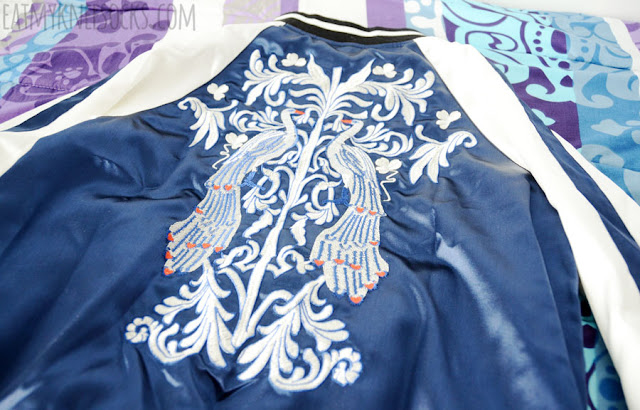Details on SheIn's reversible silk satin embroidered Asian-style bomber baseball jacket, the perfect sporty-chic fashion piece.