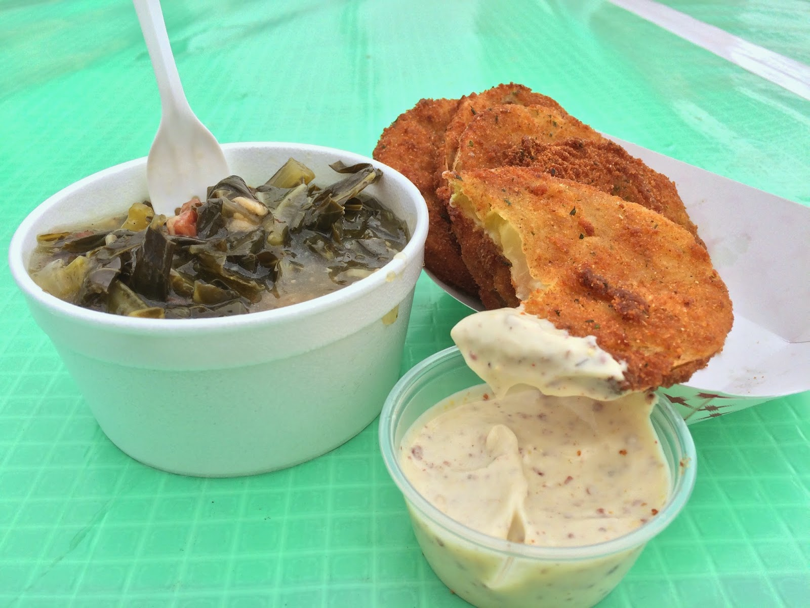 New food vendor, Squeal BBQ's Smoky Bacon Greens and classic Jazz Fest favorite, Fried Green Tomatoes