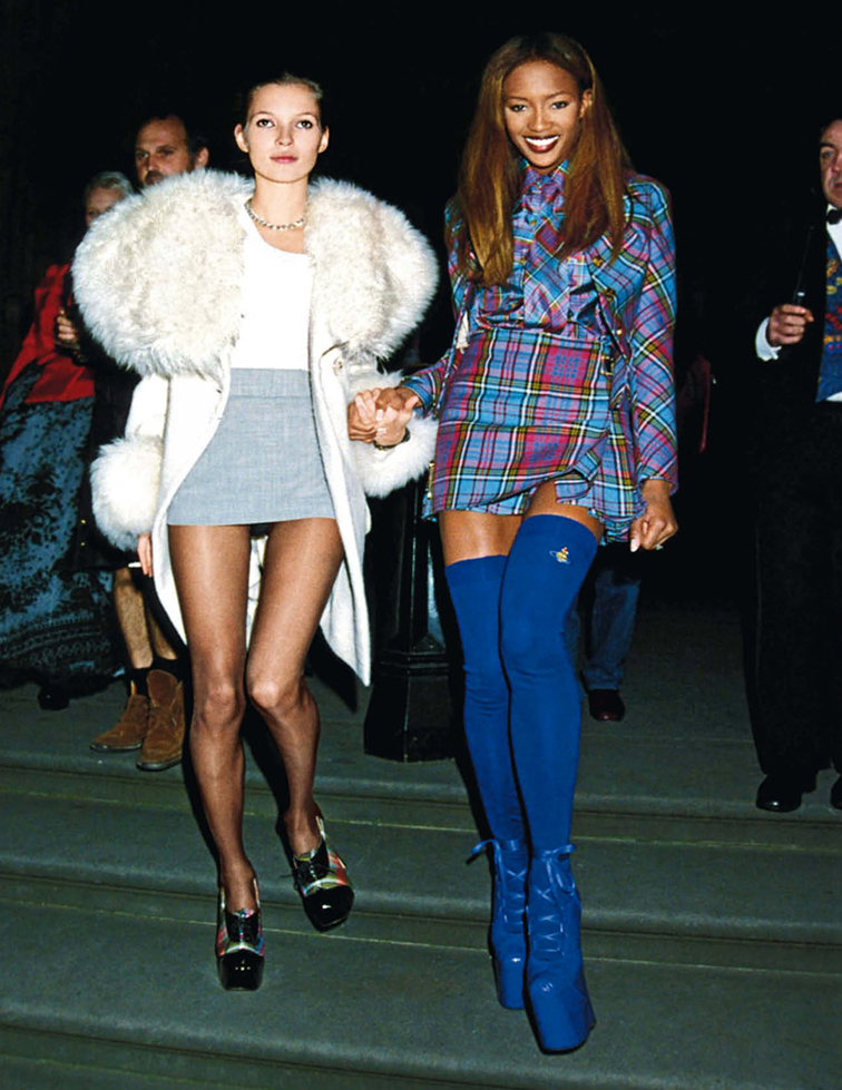 Kate Moss & Naomi Campbell at London fashion week designer of the year awards 1991