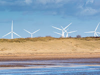 Coastal wind farm (Photo Credit: iStockphoto) Click to Enlarge.