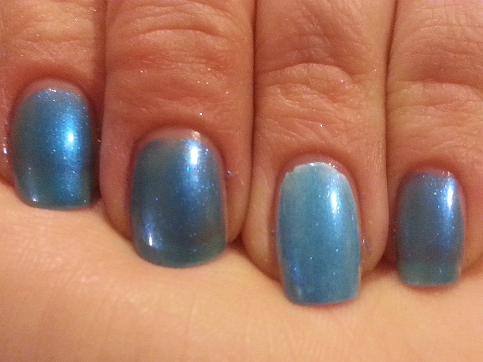 A Bad Case Of Blueballs Has A Turquoise Blue Jelly Base With Tons Of Turquoise Blue Shimmer I Have On 4 Coats With No Undie And 2 Coats On Over A White