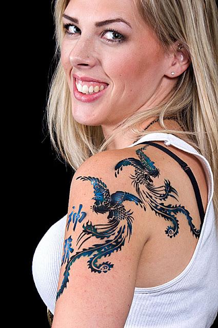 closeup kanji and peacock airbrush tattoo