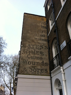 Ghost sign for Bates Salves, Cures Wounds & Sores, Regent Square, London WC1