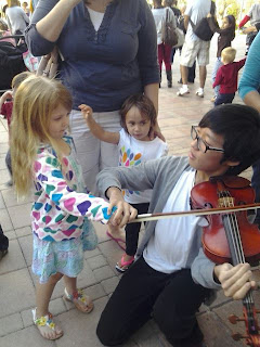 Child Touching Violin at Music for Munchkins