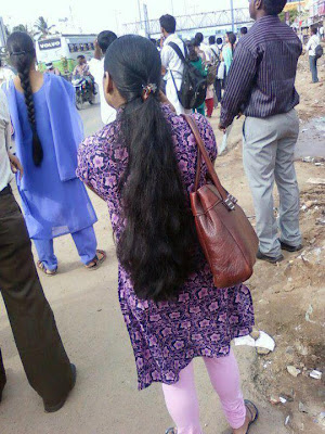 long hair girl wearing churidar on way to college.