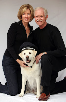 Lorrie and Sully Sullenberger with Twinkle wearing pilot's hat