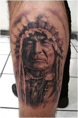 Tatuagem de indio na panturrilha